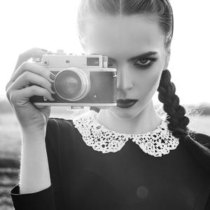 Postcard girl with vintage camera