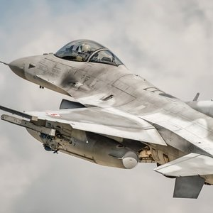 Postcard f-16c in the sky